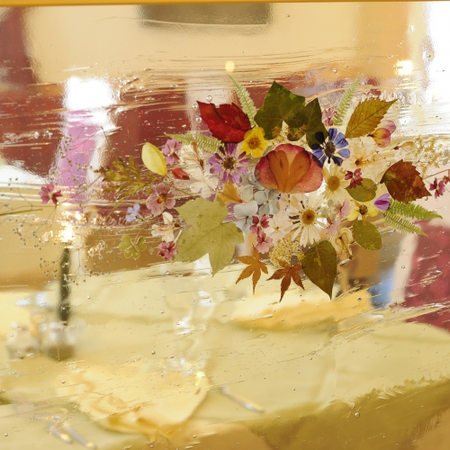 Dettaglio fiori nel vetro Hotel Tirol